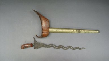 <em>Kris (Dagger) with Scabbard</em>. Wood, (in sheath) 7 7/8 x 19 1/2 in. (20 x 49.5 cm). Brooklyn Museum, Brooklyn Museum Collection, 34.57a-b. Creative Commons-BY (Photo: Brooklyn Museum, CUR.34.57a-b.jpg)