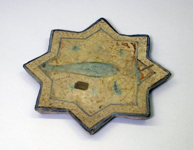 <em>Eight-Point Star Tile</em>, 14th century. Ceramic, 9/16 x 7 7/8 in. (1.5 x 20 cm). Brooklyn Museum, Brooklyn Museum Collection, 34.6029. Creative Commons-BY (Photo: Brooklyn Museum, CUR.34.6029.jpg)
