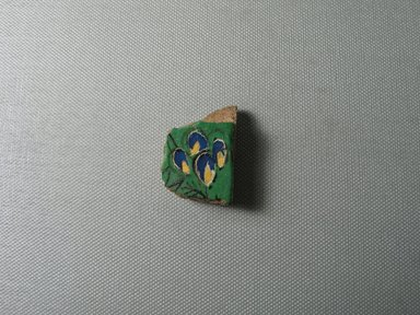 <em>Tile Fragment</em>, ca. 1352-1336 B.C.E. Faience, 1 1/2 × 1 × 11/16 in. (3.8 × 2.5 × 1.7 cm). Brooklyn Museum, Gift of the Egypt Exploration Society, 34.6044. Creative Commons-BY (Photo: , CUR.34.6044_view01.jpg)