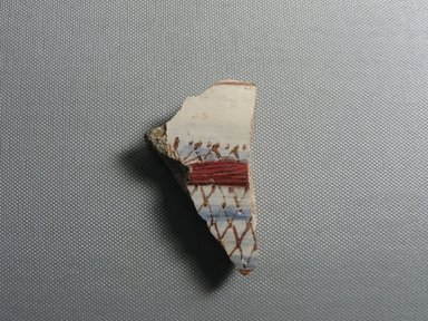 <em>Fragment of a Fish</em>, ca. 1352-1336 B.C.E. Faience, 1 5/8 × 1/2 × 2 13/16 in. (4.2 × 1.2 × 7.2 cm). Brooklyn Museum, Gift of the Egypt Exploration Society, 34.6045. Creative Commons-BY (Photo: , CUR.34.6045_view01.jpg)