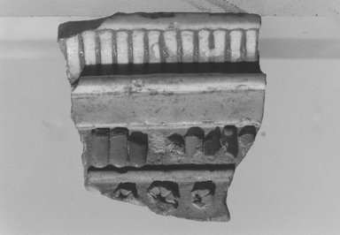 <em>Fragment of Cornice</em>, ca. 1353-1329 B.C.E. Faience, 1 7/8 x 1 13/16 in. (4.8 x 4.6 cm). Brooklyn Museum, Gift of the Egypt Exploration Society, 34.6046. Creative Commons-BY (Photo: Brooklyn Museum, CUR.34.6046_NegL1006_18_print_bw.jpg)