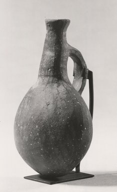 Possibly Greek. <em>Bottle</em>, ca. 1352-1336 B.C.E. Terracotta, 4 3/4 x Diam. 2 15/16 in. (12.1 x 7.4 cm). Brooklyn Museum, Gift of the Egypt Exploration Society, 34.6047. Creative Commons-BY (Photo: Brooklyn Museum, CUR.34.6047_print_NegA_bw.jpg)