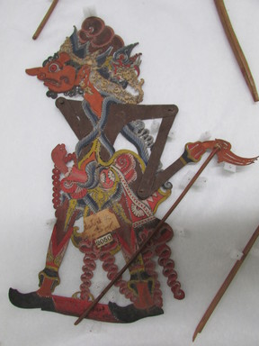 <em>Shadow Play Figure (Wayang kulit)</em>. Leather, pigment, wood, fiber, 10 1/4 × 13 in. (26 × 33 cm). Brooklyn Museum, Brooklyn Museum Collection, 34.63. Creative Commons-BY (Photo: , CUR.34.63_overall.jpg)