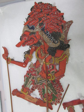 <em>Shadow Play Figure (Wayang kulit)</em>. Leather, pigment, wood, fiber, 20 11/16 × 10 5/8 in. (52.5 × 27 cm). Brooklyn Museum, Brooklyn Museum Collection, 34.65. Creative Commons-BY (Photo: , CUR.34.65_overall.jpg)