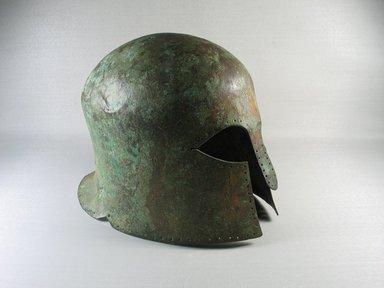 Greek. <em>Greek Helmet</em>, ca. 600 B.C.E. Bronze, 9 1/16in. (23cm). Brooklyn Museum, Charles Edwin Wilbour Fund, 34.692. Creative Commons-BY (Photo: Brooklyn Museum, CUR.34.692_view1.jpg)