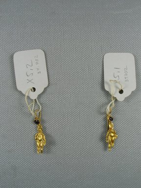 <em>Pair of Pendant Earrings</em>, 2nd century B.C.E. Gold, garnet, 34.702a: 1 5/16 in. (3.3 cm). Brooklyn Museum, Charles Edwin Wilbour Fund, 34.702a-b. Creative Commons-BY (Photo: Brooklyn Museum, CUR.34.702_overall.jpg)