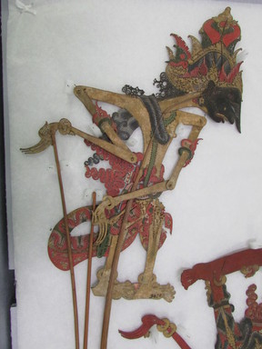 <em>Shadow Play Figure (Wayang kulit)</em>. Leather, pigment, wood, fiber, metal, 22 1/4 × 9 5/8 in. (56.5 × 24.5 cm). Brooklyn Museum, Brooklyn Museum Collection, 34.70. Creative Commons-BY (Photo: , CUR.34.70_overall.jpg)