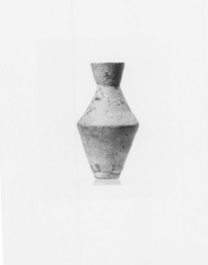 Attic. <em>Miniature Vase</em>, 4th century B.C.E. (probably). Clay, 1 3/8 x Max. diam. 3/4 in. (3.5 x 1.9 cm). Brooklyn Museum, Charles Edwin Wilbour Fund, 34.723. Creative Commons-BY (Photo: Brooklyn Museum, CUR.34.723_NegA_print_bw.jpg)