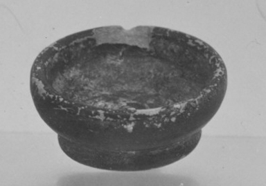 Attic. <em>Miniature Bowl</em>, 4th century B.C.E. (probably). Terracotta, pigment, 9/16 x Diam. 1 1/4 in. (1.4 x 3.2 cm). Brooklyn Museum, Charles Edwin Wilbour Fund, 34.724. Creative Commons-BY (Photo: Brooklyn Museum, CUR.34.724_print_cropped_bw.jpg)