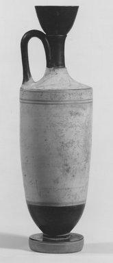 Greek. <em>White-Ground Lekythos</em>, ca. 425 B.C.E. Clay, pigment, 9 1/4 × Diam. 2 11/16 in. (23.5 × 6.8 cm). Brooklyn Museum, Charles Edwin Wilbour Fund, 34.730. Creative Commons-BY (Photo: Brooklyn Museum, CUR.34.730_NegA_print_bw.jpg)