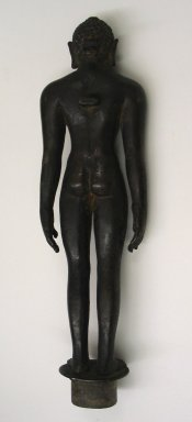 <em>Large Figure of Jina</em>, 11th-13th century. Brass, 13 1/2 x 3 13/16 in. (34.3 x 9.7 cm). Brooklyn Museum, Brooklyn Museum Collection, 34.743. Creative Commons-BY (Photo: Brooklyn Museum, CUR.34.743_back.jpg)