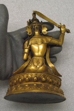 <em>Manjushri</em>, 18th-19th century. Gilded copper, 6 5/16 x 4 5/16 in. (16 x 11 cm). Brooklyn Museum, Brooklyn Museum Collection, 34.799. Creative Commons-BY (Photo: Brooklyn Museum, CUR.34.799_back.jpg)