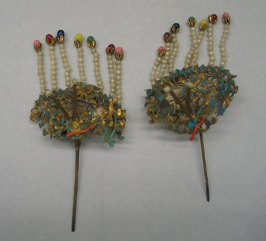 <em>Hair Ornament</em>, 19th century. Gilded brass, coral, beads, kingfisher's feather, Each: 2 3/8 x 4 15/16 in. (6 x 12.5 cm). Brooklyn Museum, Brooklyn Museum Collection, 34.937. Creative Commons-BY (Photo: Brooklyn Museum, CUR.34.937_view1.jpg)