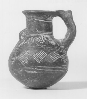 Cypriot. <em>Jug with Wide Neck</em>, 1925-1800 B.C.E. Clay, 3 7/16 in. (8.8 cm). Brooklyn Museum, Brooklyn Museum Collection, 35.1063. Creative Commons-BY (Photo: Brooklyn Museum, CUR.35.1063_NegA_print_bw.jpg)