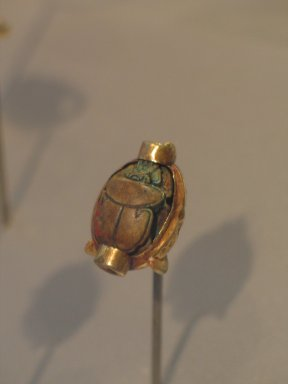 <em>Mounted Scarab of Hatshepsut</em>, ca. 1478-1458 B.C.E. Gold, steatite, glaze, 9/16 × 7/8 in. (1.4 × 2.2 cm). Brooklyn Museum, Gift of Theodora Wilbour from the collection of her father, Charles Edwin Wilbour, 35.1118. Creative Commons-BY (Photo: Brooklyn Museum, CUR.35.1118_erg456.jpg)
