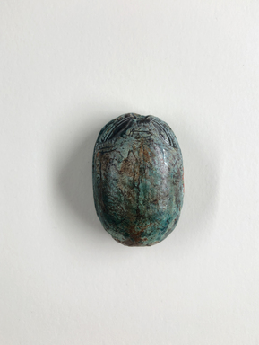 <em>Scarab</em>, 664-332 B.C.E., or later. Steatite, glaze, 9/16 × 1 1/8 × 1 5/8 in. (1.5 × 2.9 × 4.1 cm). Brooklyn Museum, Gift of Theodora Wilbour from the collection of her father, Charles Edwin Wilbour, 35.1137. Creative Commons-BY (Photo: , CUR.35.1137_view01.jpg)