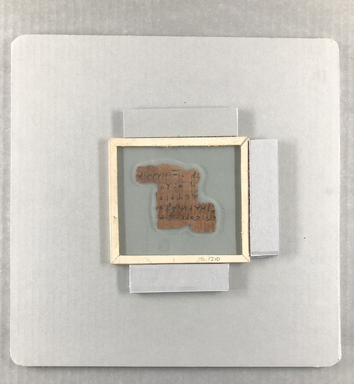<em>Papyrus Fragment Inscribed in Greek</em>, 3rd century B.C.E. (probably). Papyrus, ink, Glass: 4 1/2 x 5 in. (11.5 x 12.7 cm). Brooklyn Museum, Gift of Theodora Wilbour from the collection of her father, Charles Edwin Wilbour, 35.1210 (Photo: Brooklyn Museum, CUR.35.1210_view01_121020.jpg)