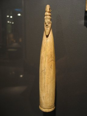 <em>Hippopotamus Tusk with Carved Head</em>, ca. 3800-3400 B.C.E. Hippopotamus ivory, 8 5/8 × 1 5/16 in. (21.9 × 3.3 cm). Brooklyn Museum, Charles Edwin Wilbour Fund, 35.1266. Creative Commons-BY (Photo: Brooklyn Museum, CUR.35.1266_erg3.jpg)