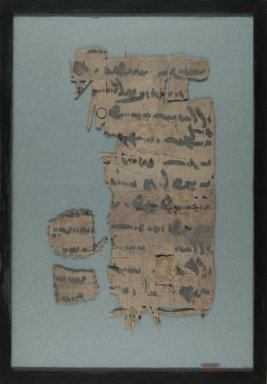 <em>Papyrus Fragments Inscribed with Text Written in Pahlavi</em>, 1st millennium B.C.E. Papyrus, ink, Glass: 10 13/16 x 15 9/16 in. (27.5 x 39.5 cm). Brooklyn Museum, Gift of Theodora Wilbour, 35.1452 (Photo: Brooklyn Museum, CUR.35.1452_front_IMLS_PS5.jpg)