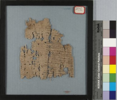 <em>Papyrus Fragment Inscribed in Greek</em>, 2nd century C.E. Papyrus, ink, Glass: 9 1/4 x 10 1/16 in. (23.5 x 25.5 cm). Brooklyn Museum, Gift of Theodora Wilbour, 35.1461. Creative Commons-BY (Photo: Brooklyn Museum, CUR.35.1461_IMLS_PS5.jpg)