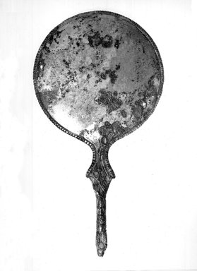 Etruscan. <em>Mirror</em>, 4th-3rd century B.C.E. Metal nearer brass than bronze, 4 3/16 x 8 3/4 in. (10.7 x 22.2 cm). Brooklyn Museum, Charles Edwin Wilbour Fund, 35.1650. Creative Commons-BY (Photo: Brooklyn Museum, CUR.35.1650_NegB_print_bw.jpg)