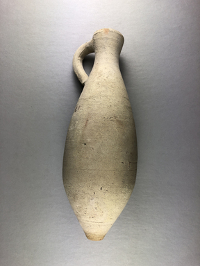 <em>Small Jug</em>, 222-650 C.E. Clay, 8 7/16 × 3 9/16 × 3 5/16 in. (21.5 × 9 × 8.4 cm). Brooklyn Museum, Gift of the American Institute for Persian Art and Archaelogy, 35.1943. Creative Commons-BY (Photo: , CUR.35.1943_view01.jpg)