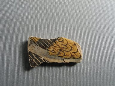 <em>Fragment Depicting Two Wings</em>, ca. 1352-1332 B.C.E. Faience, 1 5/8 × 3/8 × 3 1/16 in. (4.2 × 1 × 7.8 cm). Brooklyn Museum, Gift of the Egypt Exploration Society, 35.2007. Creative Commons-BY (Photo: , CUR.35.2007_view01.jpg)