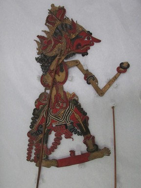 <em>Shadow Play Figure (Wayang kulit)</em>. Leather, pigment, wood, fiber, 20 1/16 × 10 1/4 in. (51 × 26 cm). Brooklyn Museum, Gift of Appleton Sturgis, 35.2113. Creative Commons-BY (Photo: , CUR.35.2113_overall.jpg)