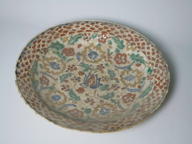 <em>Large Plate</em>, 17th century. Ceramic, Kubachi ware; fritware, painted in olive green, cobalt blue and green with red and yellow slips under a transparent glaze, 2 5/8 x 14 3/16 in. (6.7 x 36 cm). Brooklyn Museum, Gift of Frank L. Babbott, 35.676. Creative Commons-BY (Photo: Brooklyn Museum, CUR.35.676.jpg)