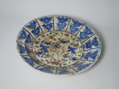 <em>Large Plate</em>, 17th century. Ceramic, Kubachi ware; fritware, painted in olive green, cobalt blue and green with red and yellow slips under a transparent glaze, 2 1/2 x 13 9/16 in. (6.4 x 34.4 cm). Brooklyn Museum, Gift of Frank L. Babbott, 35.677. Creative Commons-BY (Photo: Brooklyn Museum, CUR.35.677_interior.jpg)