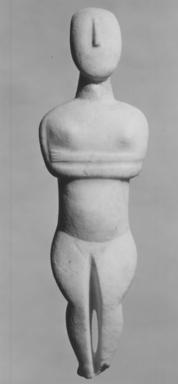 Keros-Syros. <em>Folded-Arm Female Figurine</em>, ca. 3100-3000 B.C.E. Marble, 11 9/16 x 3 3/8 x 1 1/4 in. (29.3 x 8.5 x 3.2 cm). Brooklyn Museum, Charles Edwin Wilbour Fund, 35.733. Creative Commons-BY (Photo: Brooklyn Museum, CUR.35.733_NegD_print_bw.jpg)