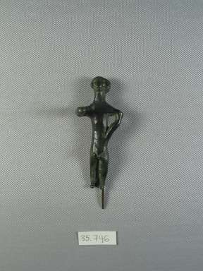 <em>Male Figure</em>, ca.1600 B.C.E. Bronze, 3 3/16 x 1 5/16 in. (8.1 x 3.4 cm). Brooklyn Museum, Charles Edwin Wilbour Fund, 35.746. Creative Commons-BY (Photo: Brooklyn Museum, CUR.35.746_view01.jpg)