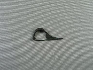 <em>Fibula in the Shape of a Bow</em>, 6th-4th century B.C.E. Bronze, Length: 2 1/16 in. (5.2 cm). Brooklyn Museum, Charles Edwin Wilbour Fund, 35.811. Creative Commons-BY (Photo: Brooklyn Museum, CUR.35.811_view01.jpg)