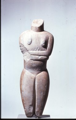 Keros-Syros. <em>Folded-Arm Female Figurine</em>, ca. 2650-2250 B.C.E. Marble, 18 1/4 x 5 7/8 x 2 1/2 in. (46.4 x 15 x 6.3 cm). Brooklyn Museum, Charles Edwin Wilbour Fund, 35.812. Creative Commons-BY (Photo: Brooklyn Museum, CUR.35.812.jpg)