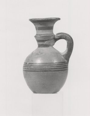 Cypriot. <em>Oinochoe</em>, 700-600 B.C.E. Terracotta, pigment, Height: 2 9/16 in. (6.5 cm). Brooklyn Museum, Brooklyn Museum Collection, 35.825. Creative Commons-BY (Photo: Brooklyn Museum, CUR.35.825_print_NegA_bw.jpg)