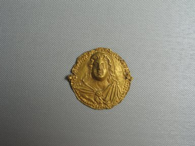 Byzantine. <em>Impressed face</em>, 350 C.E. Gold, 1 15/16 x 1/4 x 2 in. (5 x 0.6 x 5.1 cm). Brooklyn Museum, Frank L. Babbott Fund and Henry L. Batterman Fund, 36.159a. Creative Commons-BY (Photo: Brooklyn Museum, CUR.36.159a_view01.jpg)