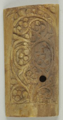 Byzantine. <em>Plaque with Botanical Decoration</em>, 5th-6th century C.E. Bone, 1 1/2 x 2 15/16 in. (3.8 x 7.4 cm). Brooklyn Museum, Frank L. Babbott Fund and Henry L. Batterman Fund, 36.168.3. Creative Commons-BY (Photo: Brooklyn Museum (in collaboration with Index of Christian Art, Princeton University), CUR.36.168.3_ICA.jpg)