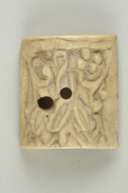 Byzantine. <em>Plaque with Botanical Decoration</em>, 5th-6th century C.E. Bone, 1 5/16 x 1 1/2 in. (3.4 x 3.8 cm). Brooklyn Museum, Frank L. Babbott Fund and Henry L. Batterman Fund, 36.168.4. Creative Commons-BY (Photo: Brooklyn Museum (in collaboration with Index of Christian Art, Princeton University), CUR.36.168.4_ICA.jpg)