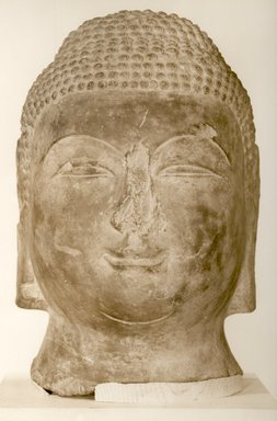 <em>Large Head of a Buddha</em>, 618-906. Limestone, 14 3/16 x 9 1/16 x 10 5/8 in. (36 x 23 x 27 cm). Brooklyn Museum, Caroline H. Polhemus Fund, 36.272. Creative Commons-BY (Photo: Brooklyn Museum, CUR.36.272_bw.jpg)
