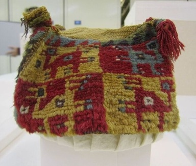 Wari. <em>Hat</em>, 600-1000 C.E. Camelid fiber, 5 1/2 x 7 1/16in. (14 x 18cm). Brooklyn Museum, Gift of Mrs. Eugene Schaefer, 36.400. Creative Commons-BY (Photo: , CUR.36.400_view04.jpg)