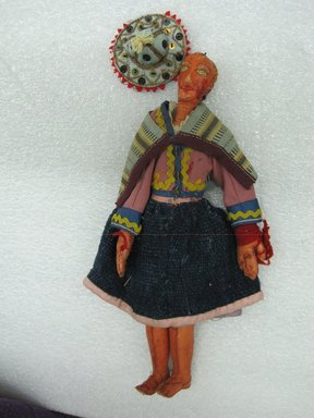 <em>Female Doll</em>, ca. 1936. Leather, wool, cotton, sequins, 10 1/4 x 2 9/16 in. (26 x 6.5 cm). Brooklyn Museum, Gift of Dr. John H. Finney, 36.689. Creative Commons-BY (Photo: Brooklyn Museum, CUR.36.689_view1.jpg)