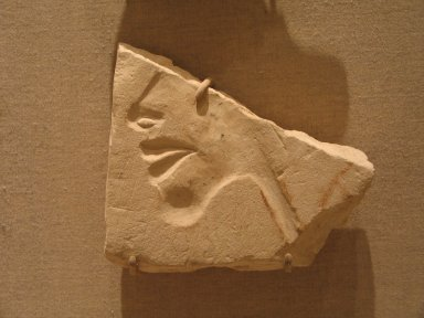 <em>Fragment of a Face</em>, ca. 1352-1336 B.C.E. Limestone, 3 7/8 x 4 7/16 x 7/8 in. (9.8 x 11.2 x 2.3 cm). Brooklyn Museum, Gift of the Egypt Exploration Society, 36.875. Creative Commons-BY (Photo: Brooklyn Museum, CUR.36.875_wwg7.jpg)