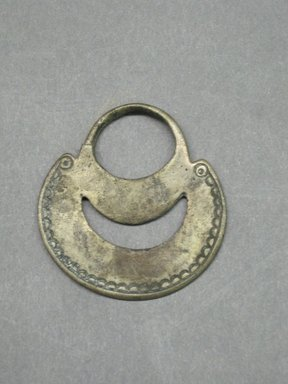 Araucanian. <em>Earring</em>, 18th century. Silver, 1 1/2 x 1 9/16 in. (3.8 x 4 cm). Brooklyn Museum, Ella C. Woodward Memorial Fund, 36.936. Creative Commons-BY (Photo: Brooklyn Museum, CUR.36.936.jpg)