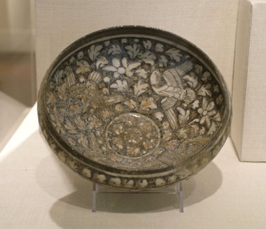 "<em>Bowl with Flying Birds and Lotuses</em>, 14th century. Ceramic, ""Sultanabad"" ware; stone paste, painted in cobalt blue and black under a transparent glaze, 4 5/16 x 8 11/16 in. (11 x 22 cm). Brooklyn Museum, Gift of Mr. and Mrs. Frederic B. Pratt, 36.943. Creative Commons-BY (Photo: Brooklyn Museum, CUR.36.943.jpg)"