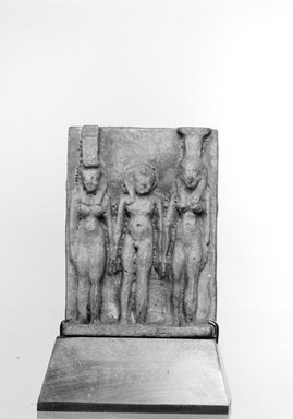 <em>Triad of Isis, Horus and Nephthys</em>. Faience, glazed, 1 3/4 x 1 5/16 x 1/2 in. (4.4 x 3.3 x 1.3 cm). Brooklyn Museum, Charles Edwin Wilbour Fund, 37.1000E. Creative Commons-BY (Photo: Brooklyn Museum, CUR.37.1000E_NegID_37.1000E_GRPA_cropped_bw.jpg)