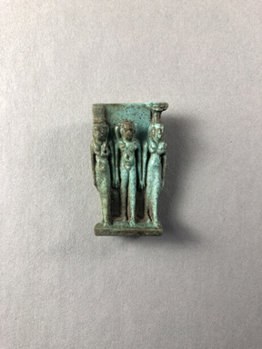 <em>Small Triad of  Isis, Horus and Nephthys</em>, ca. 664-525 B.C.E. Faience, 1 5/16 × 13/16 × 7/16 in. (3.3 × 2 × 1.1 cm). Brooklyn Museum, Charles Edwin Wilbour Fund, 37.1002E. Creative Commons-BY (Photo: , CUR.37.1002E_view01.jpg)