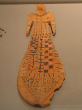 <em>Paddle Doll</em>, ca. 2081-1700 B.C.E. Wood, mud, pigment, 9 x 2 5/8 x 3/16 in. (22.8 x 6.7 x 0.5 cm)Measurements: Ht. 22.8 cm.; greatest width c. 6.7 cm.; thickness 0.5 cm. Brooklyn Museum, Charles Edwin Wilbour Fund, 37.102E. Creative Commons-BY (Photo: Brooklyn Museum, CUR.37.102E_erg456.jpg)