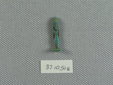 <em>Small Figurine of Mut</em>. Faience, glazed, 15/16 x 1/4 x 1/4 in. (2.4 x 0.6 x 0.7 cm). Brooklyn Museum, Charles Edwin Wilbour Fund, 37.1050E. Creative Commons-BY (Photo: Brooklyn Museum, CUR.37.1050E_view01.jpg)