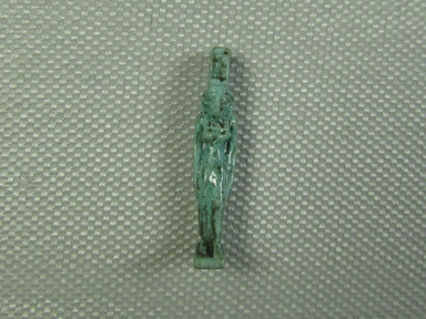 <em>Isis Amulet</em>, 664–332 B.C.E. Faience, 1 3/16 x 1/4 x 5/16 in. (3 x 0.6 x 0.8 cm). Brooklyn Museum, Charles Edwin Wilbour Fund, 37.1076E. Creative Commons-BY (Photo: Brooklyn Museum, CUR.37.1076E_view1.jpg)