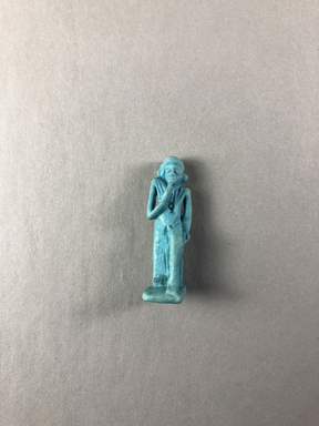 <em>Amulet of the Child Horus</em>, 664-332 B.C.E. Faience, 1 5/8 × 1/2 × 9/16 in. (4.1 × 1.3 × 1.4 cm). Brooklyn Museum, Charles Edwin Wilbour Fund, 37.1094E. Creative Commons-BY (Photo: , CUR.37.1094E_view01.jpg)